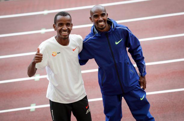 Belgian Bashir Abdi (vas.) ja britti Mo Farah ovat treenikavereita.