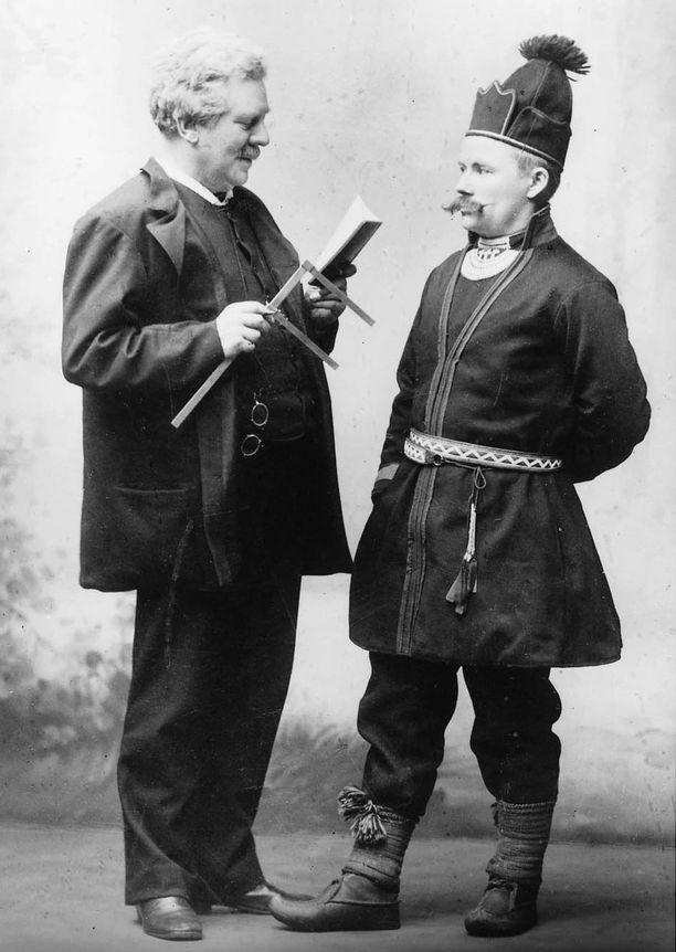Rotuprofessori Gustaf Retzius työssään ottamassa mittoja saamelaismiehen kallosta.