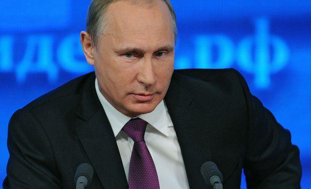 Venäjän presidentti Vladimir Putin tiedotustilaisuudessa joulukuussa.