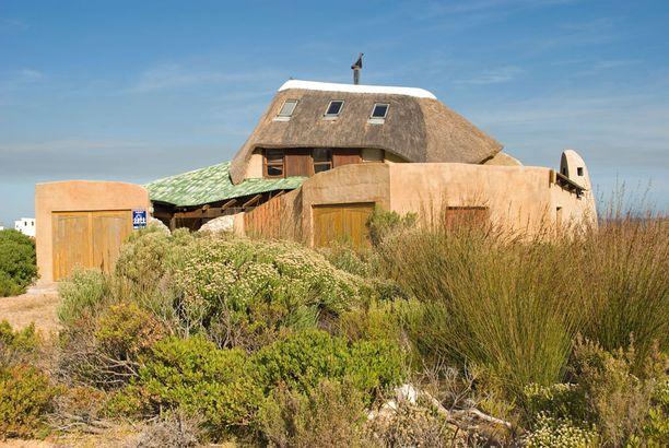 Hobittimaista arkkitehtuuria löytyy myös Etelä-Afrikasta: tämän Betty's Bayssa sijaitsevan talon voisi kuvitella olevan vaikkapa Konnun lähistöllä sijaitsevasta Briistä, jossa hobitit ja ihmiset elävät rinnakkain.