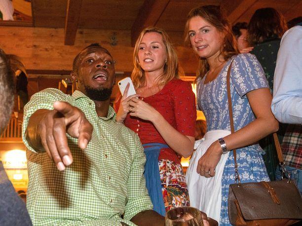 Usain Bolt viihtyy kosteissa juhlissa. Kuva vuoden 2019 Oktoberfest-tapahtumasta.