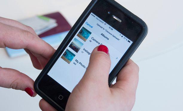 Turvallisempaa matkustamista: tallenna passista kuva pilvipalveluun.