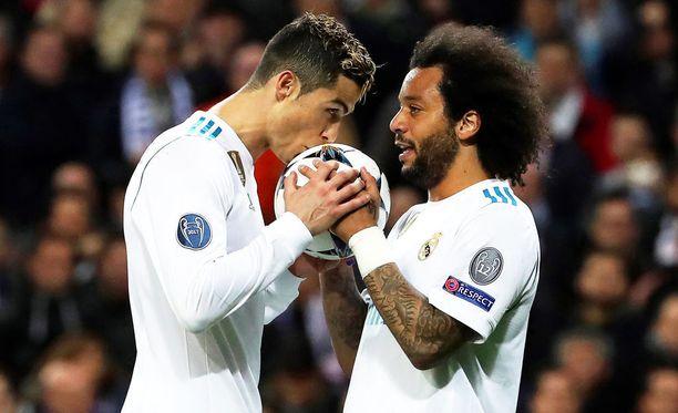 Cristiano Ronaldo (vas.) ja Marcelo olivat Real Madridin sankareita.