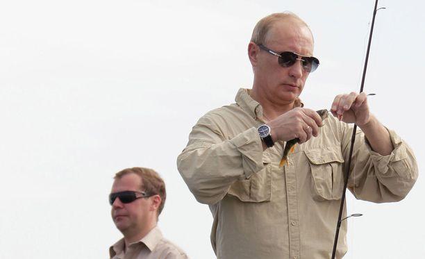 Vladimir Putin on tunnettu kalamies, joka lomailee tyylikkäästi.