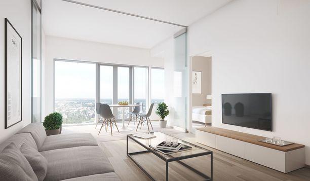 Näyttävä huonekorkeus ja isot ikkunat tekevät huoneistosta avaran.
