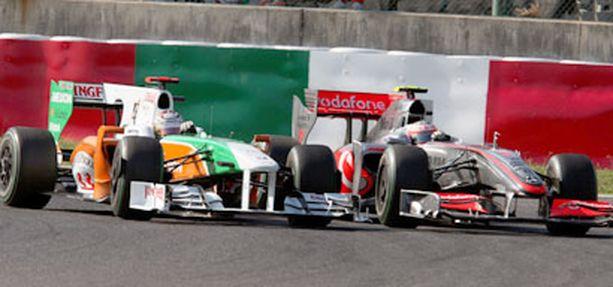 Heikki Kovalainen kamppaili ankarasti Force India-kuski Adrian Sutilin kanssa.