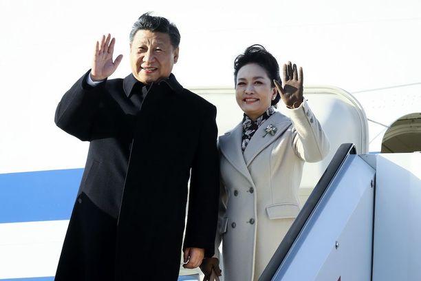 Presidentti Xi Jinping ja rouva Peng Liyuan.