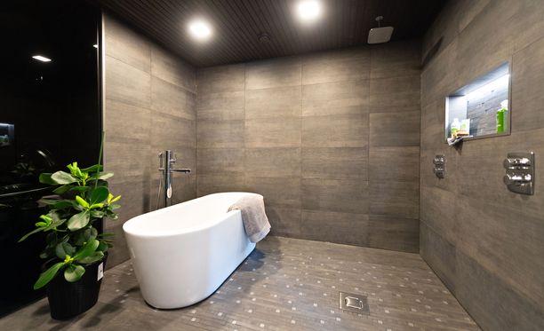 Syksyn tullen kylpyhuoneremontteja kilpailutetaan aktiivisesti. Kuva Porin asuntomessuilta.
