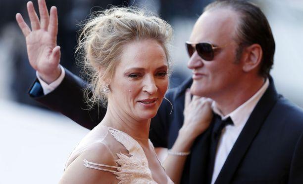 Thurman ja Tarantino Cannesin elokuvajuhlilla 2014. Thurmanin mukaan onnettomuus johti hänen ja Tarantinon pitkäaikaiseen välirikkoon.