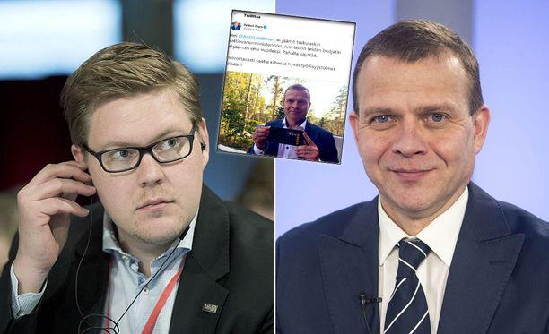Antti Lindtman (vas) ja Petteri Orpo ovat sanasodassa.