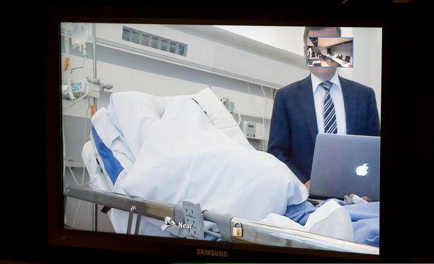Kuva Turun puukotuksesta epäillyn miehen vangitsemisoikeudenkäynnistä.