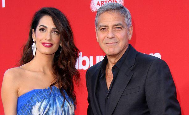 George Clooney ja vaimo Amal Clooney.