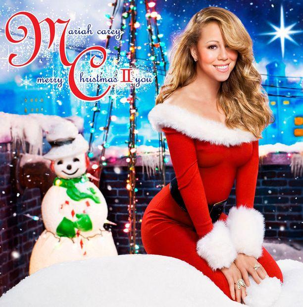 Careyn joululevyn kannessa kuva ennen raskautta.
