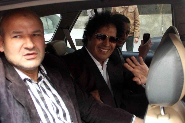 Gaddafi al-Dam (keskellä) on ollut maanpaossa Muammar Gaddafin kuolemasta lähtien.