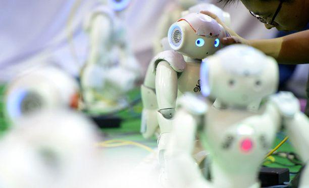 Näyttääkö tulevaisuuden seurakunta tältä? Robottikilpailu Kiinan Hefeissä.