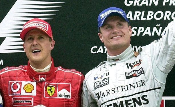 Schumacher ja Coulthard palkintopallilla Espanjassa vuonna 2002.