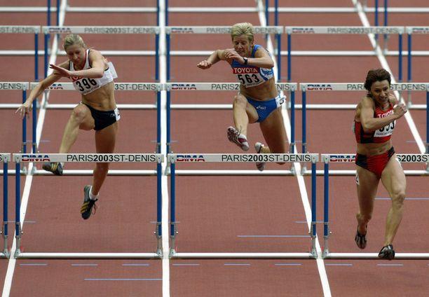 Julie Hollman, Gertrud Bacher ja Svetlana Gnezdilov seitsenottelun 100 metrin aidoissa vuoden 2003 MM-kisoissa.