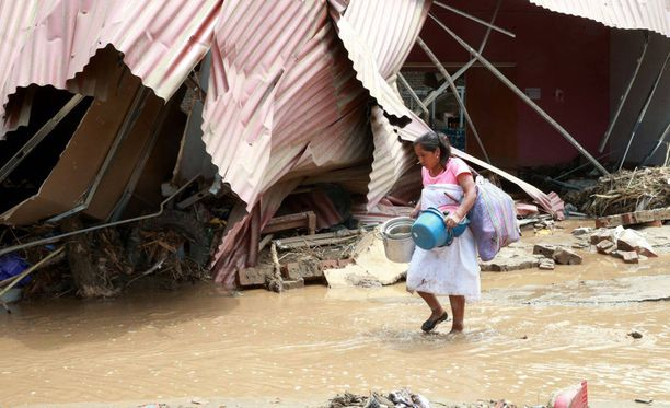 Maailman ilmatieteen järjestön WMO:n mukaan maailmanlaajuisesti tapahtuu muutoksia, jotka kyseenalaistavat käsityksemme globaalin ilmastojärjestelmän toiminnasta. Kuva on Perusta Limasta, jossa kärsitään parhaillaan pahoista tulvista.