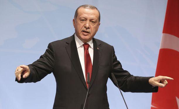 Erdogan G20-kokouksessa heinäkuussa. Presidentin loukkaaminen on Turkissa rikos.