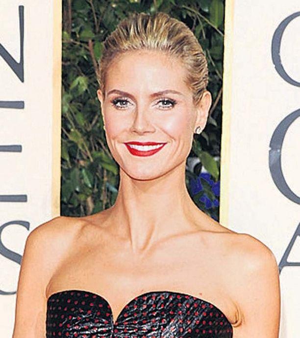 Heidi Klum poseeraa rohkeissa kuvissa.