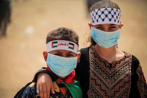 Mielenosoituksiin Israelin ja Gazan välillä osallistuneita lapsia. Kuva huhtikuun puolivälistä.