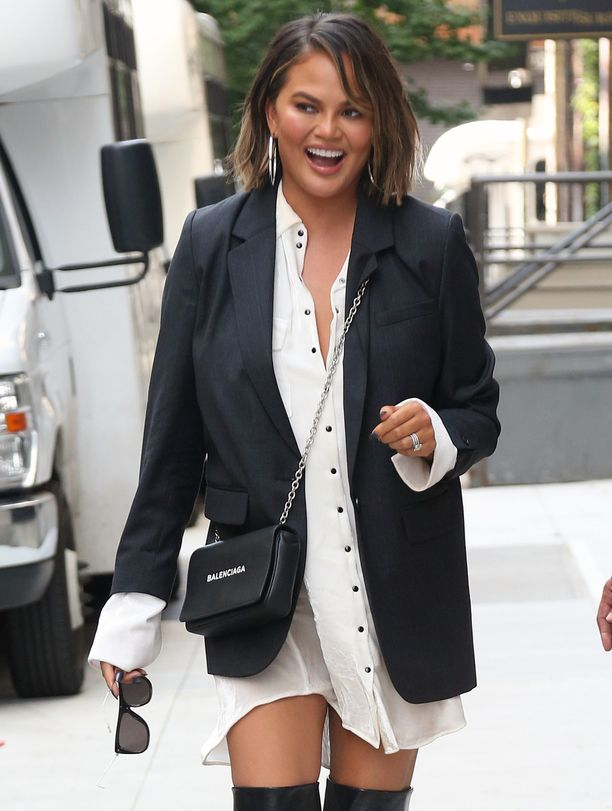 Chrissy Teigen arrives at the television studios of 'Watch What Happens Live with Andy Cohen' in New York City, NY, wearing a white shirt dress and thigh high boots.Pictured: Chrissy TeigenRef: SPL5025948 190918 NON-EXCLUSIVEPicture by: SplashNews.comSplash News and PicturesLos Angeles: 310-821-2666New York: 212-619-2666London: 0207 644 7656Milan: +39 02 4399 8577Sydney: +61 02 9240 7700photodesk@splashnews.comWorld Rights, No France Rights
