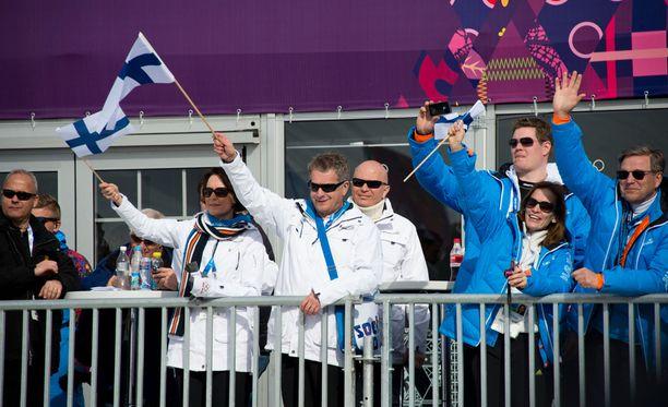 Presidentti Sauli Niinistö ja rouva Jenni Haukio kannustivat suomalaisurheilijoita Sotshissa vuonna 2014.