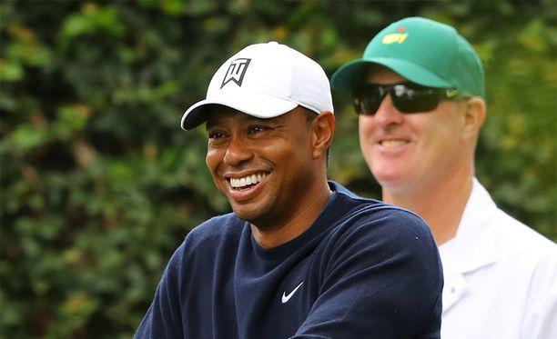 Tiger Woods hymyilee jälleen.