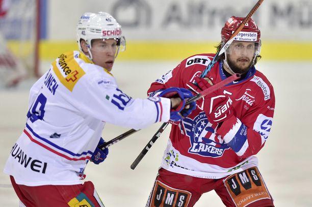 Tomi Sallinen (kuvassa vasemmalla) palaa KHL:ään.