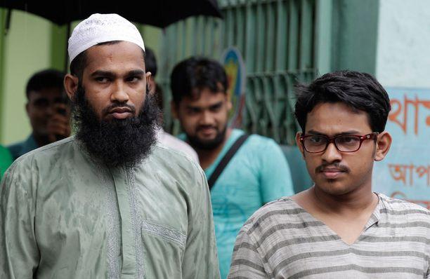 Masud Rana (vas.) ja Saad al-Nahin ovat kaksi viikkoa sitten tapahtuneen murhan pääepäiltyjä.
