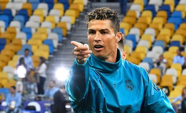 Cristiano Ronaldo ja Real Madrid hamuavat kolmatta perättäistä Mestarien liigan voittoa.