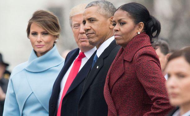 Entinen ja nykyinen presidenttipari. Michelle Obama kuvassa oikealla.