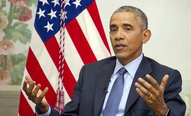 Yhdysvaltain väistyvä presidentti Barack Obama on lopettanut kuubalaissiirtolaisia koskeneen avointen ovien politiikan.