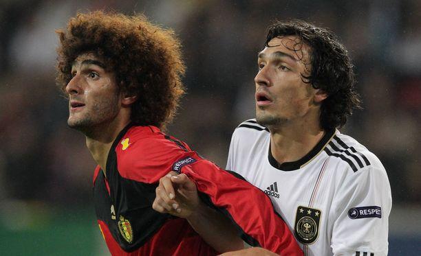 Marouane Fellaini ja Mats Hummels kohtasivat maajoukkuepelissä vuonna 2011.