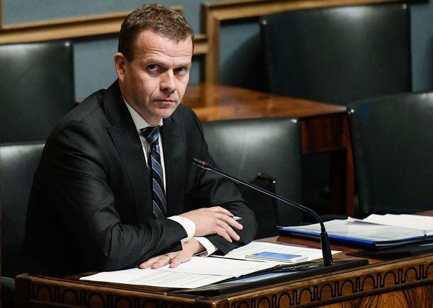 Valtiovarainministeri Petteri Orpo (kok) eduskunnan täysistunnossa lokakuussa.