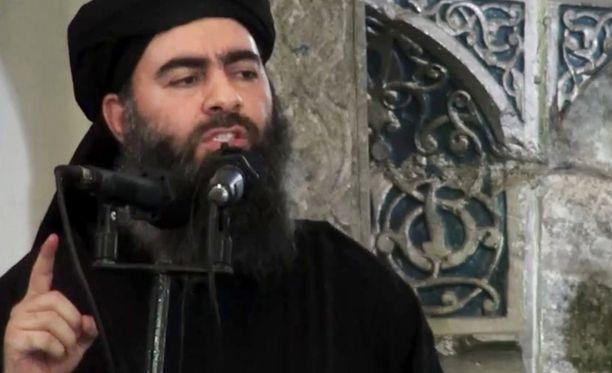 """Isisin johtaja Abu Bakr al-Baghdadi (kuvassa) on kutsunut Taliban-johtaja Mullah Mohammad Omaria """"hölmöksi ja lukutaidottomaksi sotapäälliköksi""""."""