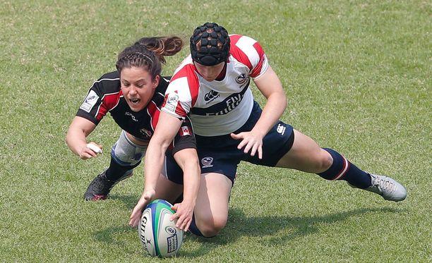 Rugbypelaajat eivät vähästä hätkähdä. Kuvituskuva.