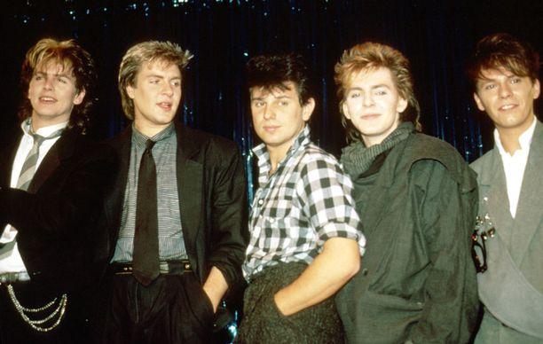 Nykykokoonpanon alkuperäisjäsenistä puuttuu vain Andy Taylor (oik.). Kuva 80-luvun alusta.