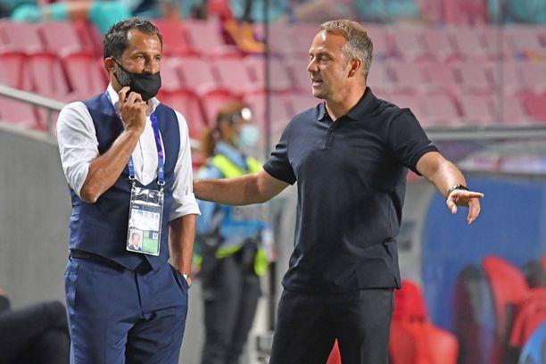 Päävalmentaja Hans Dieter Flickin (oik.) ja urheilutoimenjohtaja Hasan Salihamidzcin välit ovat tulehtuneet.
