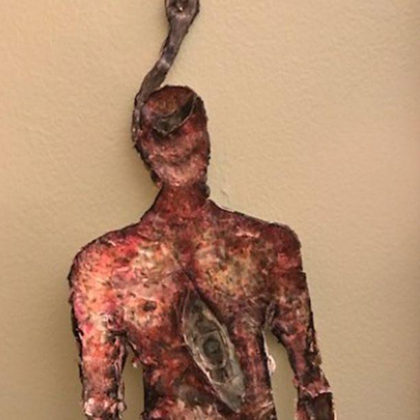"""Drabbad on mielisairaalassa ollessaan tehnyt taidetta, jota kaupataan netissä. Kyseisen teoksen nimi on """"Hanging Man"""", sen saisi omakseen 180 eurolla."""