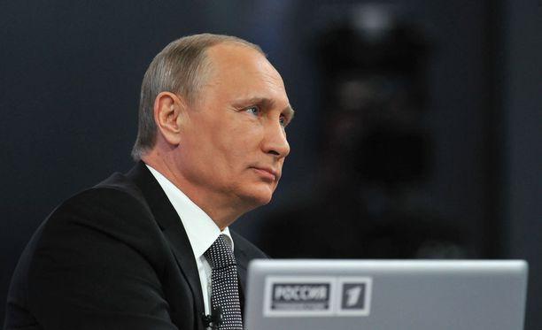 Putin vakuutteli, ettei tavallista kansaa ole talouskurimuksessa unohdettu.