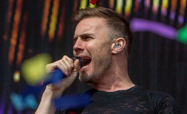 Gary Barlow on usean Take That -hitin taustalla.