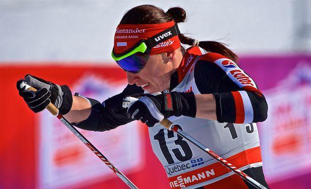 Justyna Kowalczyk (kuvassa) ei niele Therese Johaugin selityksiä.