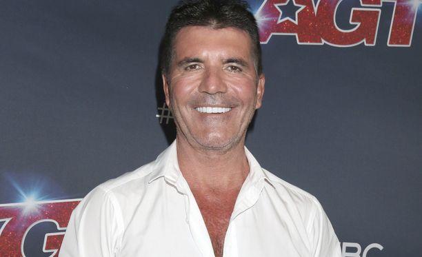 Simon Cowell on mies monien menestysyhtyeiden takana.