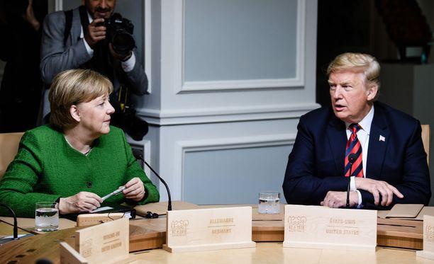 Liittokansleri Angela Merkel ja presidentti Donald Trump G7-kokouksessa Kanadassa kesäkuun alussa.