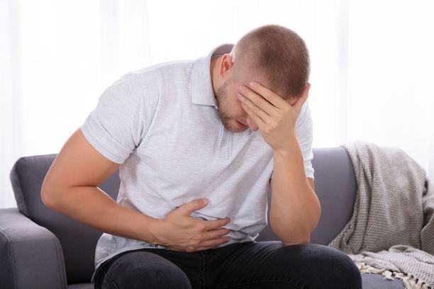 Yksi kryptosporidioosi-tartunnan mahdollisista oireista on vatsakipu.