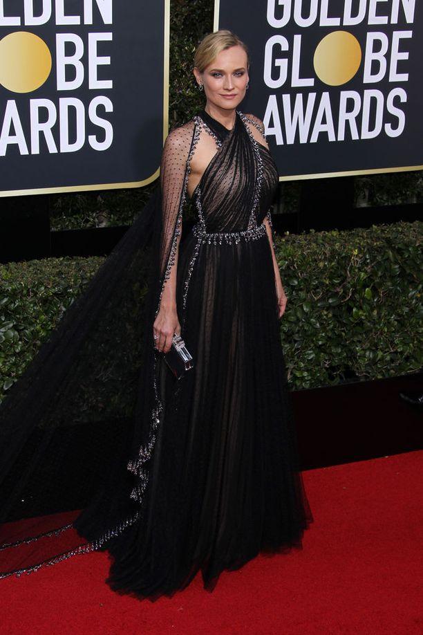 Diane Krugerin tyylitaju ei pettänyt nytkään. Upea puku on Pradan luomus.