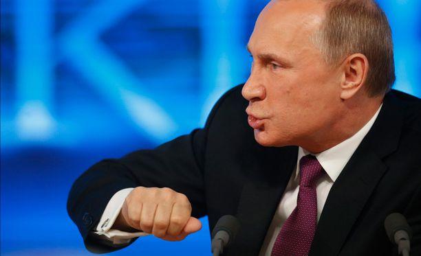 Putin kiistää Venäjän olevan aggressiivinen.