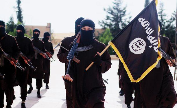 Isisin taistelijoita terroristijärjestön propagandakuvassa.