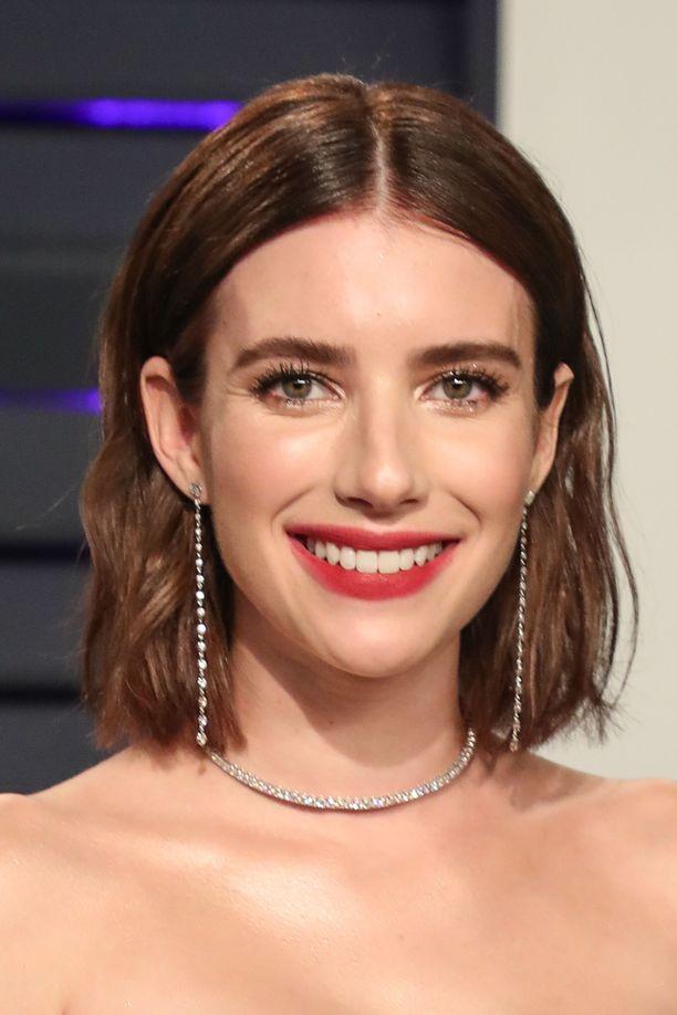 Emma Roberts sädehti Oscareiden jatkoilla uudessa, ruskeassa tukassa.